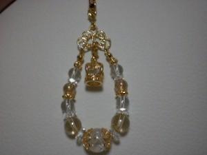 『水晶とゴールデンオーラ、王冠ストラップ 4000円』